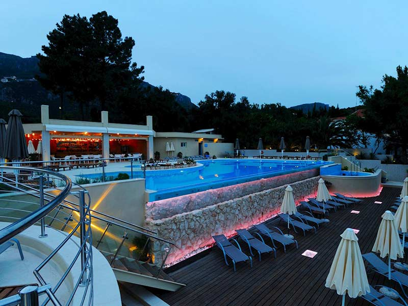 pool-by-night-akrotiri-beach-hotel